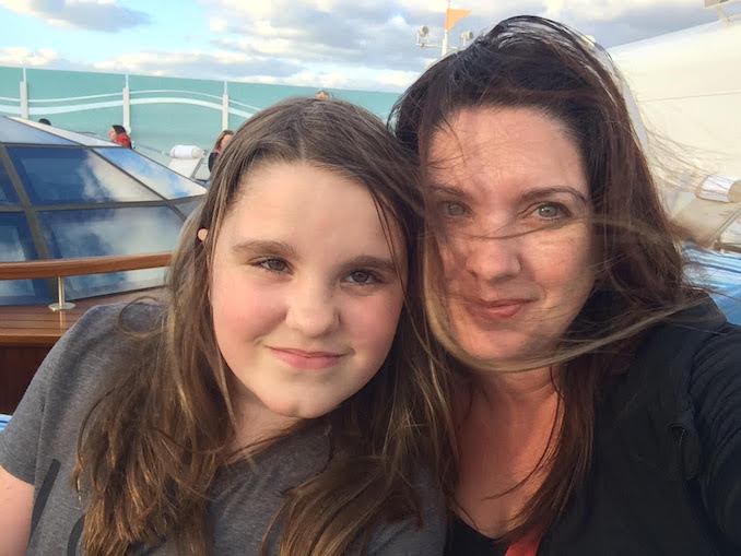My youngest and I doing our favorite thing on a cruise ship - being up top and enjoying the wind.