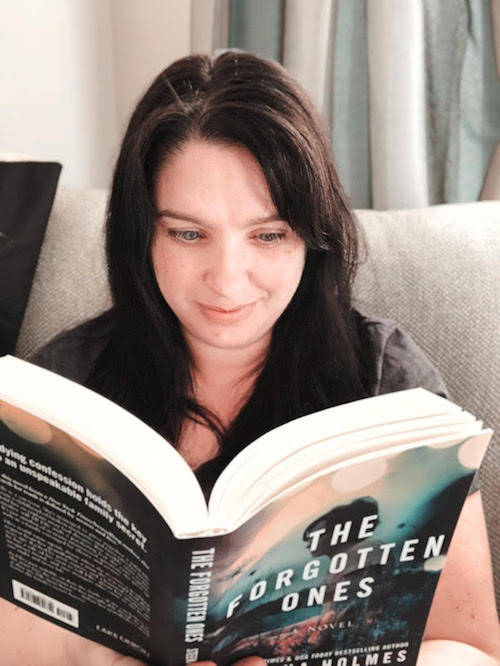 reading the first copy of The Forgotten Ones once it arrived! I love the smell of a new book and I love this story!
