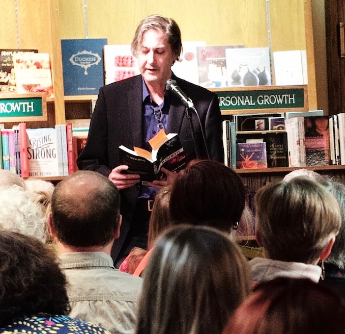 Craig DiLouie giving a reading at the Owl's Nest bookstore in Calgary