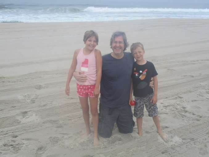 With his children at the beach in New Jersey, where he grew up. He takes his kids there every year to create magical memories of the ocean. Craig identifies as a dad more than anything else.