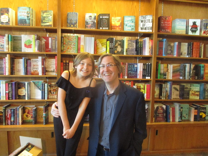 Craig DiLouie with his daughter Mieka at her book signing at the Owl's Nest bookstore Craig challenged her that if she wrote a book, he'd publish it. Her novel, She Tamed a Dragon, was on the Calgary Herald bestseller list for several weeks. All profits were donated to Inn from the Cold, a local charity that helps families in need.