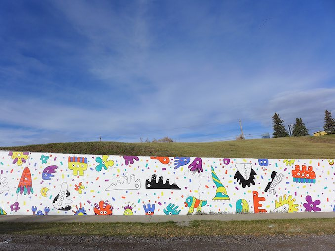 This is a section of the 74 metre community mural I helped to crowdfund and paint with the community of Ramsay on 9 Street SE.