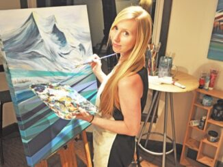 Me in my studio, painting mountains