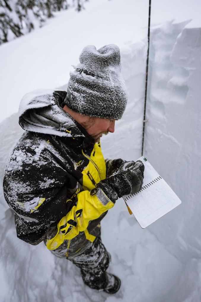 Field work involves digging snow profiles to get snowpack information.