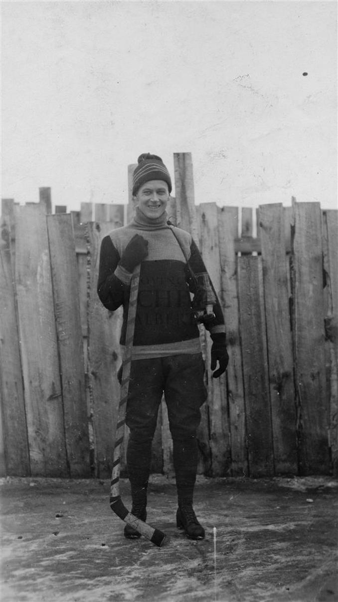 1920? - PR2009.0441.0059 - Allen Godby on ice rink with hockey stick, Mountain Park, Alberta