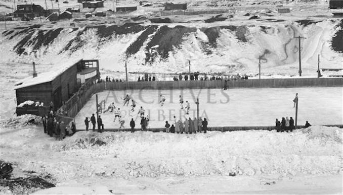 1920? - PR2009.0441.0074 - Hockey game on an open-air rink, Mountain Park, Alberta