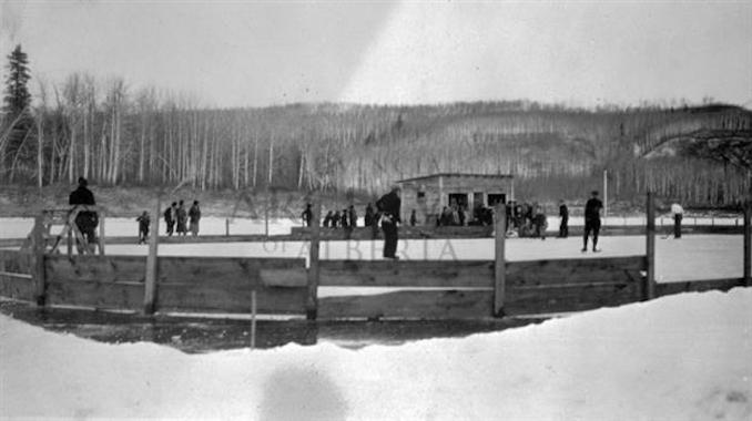 1931 - A11989 - People playing on an outdoor skating rink in Fort McMurray.