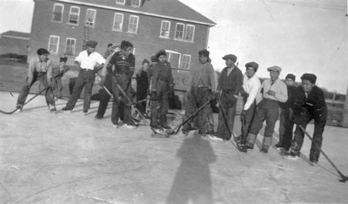 1936 - A13454 - Group of students playing outside Indian Residential School, Edmonton.