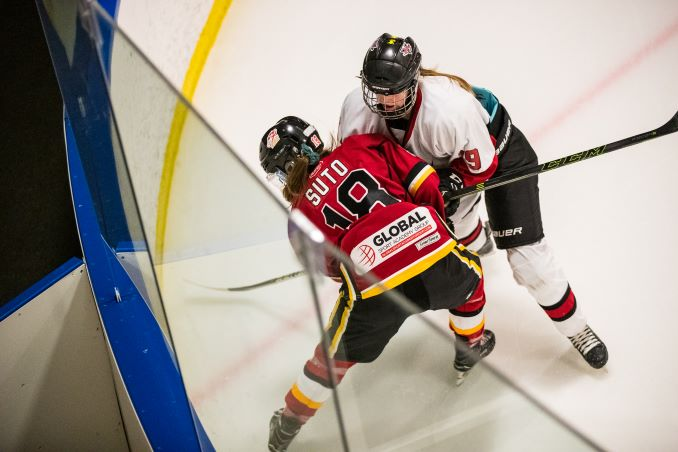 Hannah Suto, Calgary Fire Red and Emily Biggin, Airdrie Lightning in action during their game at Ed Whalen Arena, Calgary on March 3, 2019. © J. Ashley Nixon