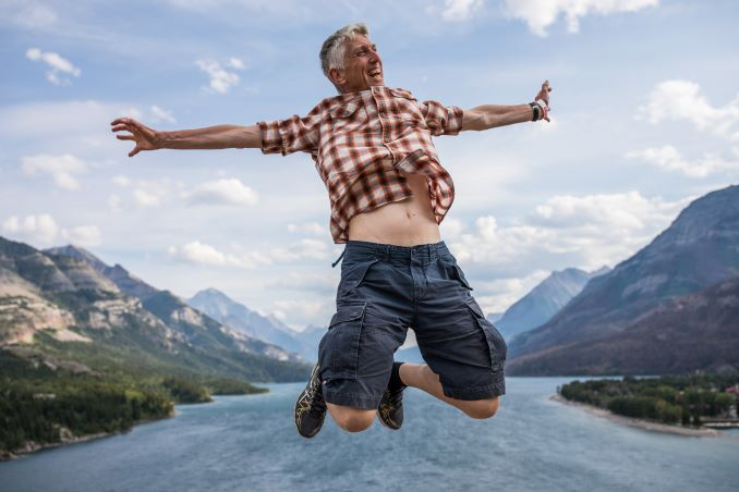 Peter Morris jumps over Waterton Lake, August 6, 2018. © J. Ashley Nixon