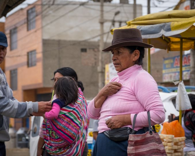 Shoppers buy food at an open market in Manchay, Lima, Peru, December 24, 2015. Part of a book published in 2018 about developing communities in Peru. © J. Ashley Nixon