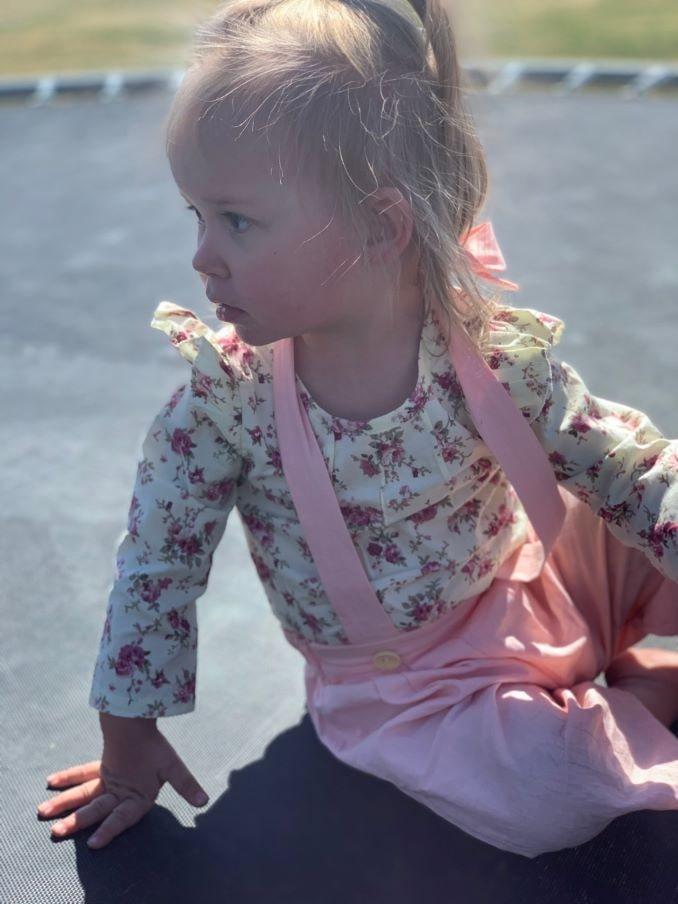 Chantel's daughter Harper Lee Rollison (2, 2020) playing on a trampoline.-min