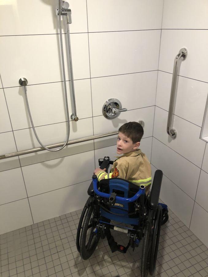 5yr old Jaydon in his new bathroom provided by ARK