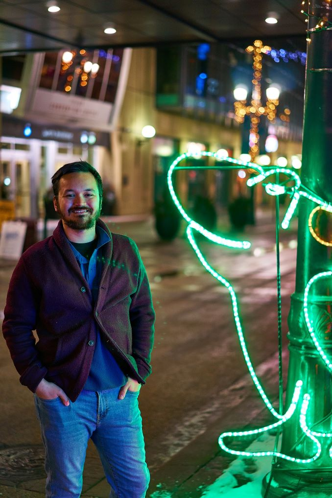 I had to have a nice photo of myself taken for another project, so naturally, I opted to have my photo taken in front of the neon frog from the Zoolights sign on Stephen Avenue. Where else would you go? (Photo credit to Steven Medeiros).