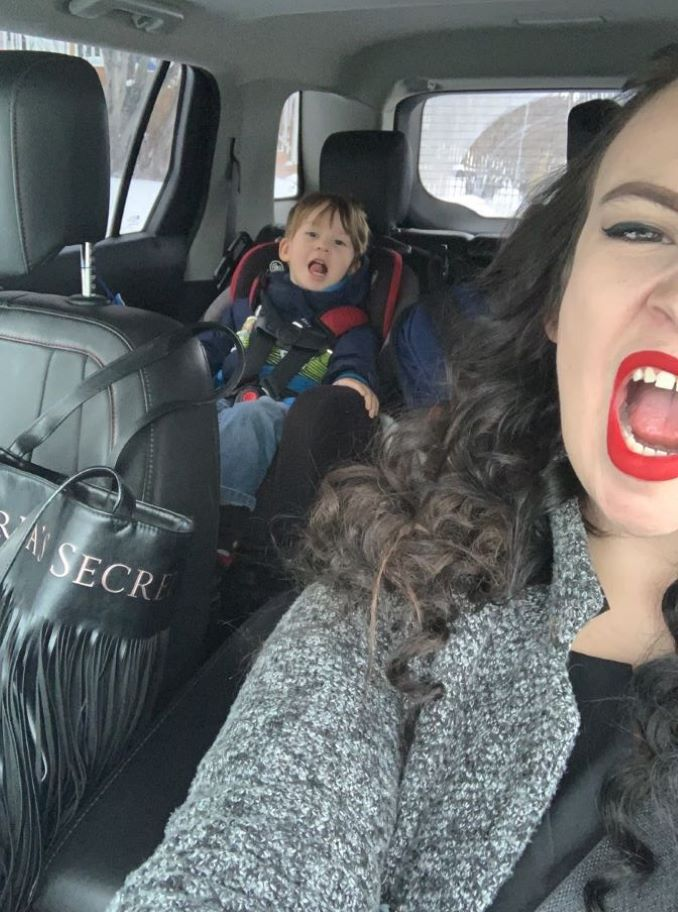 Mom (Chantel Dixon) and son (Beau Rollison) being goofy in mom's car.-min