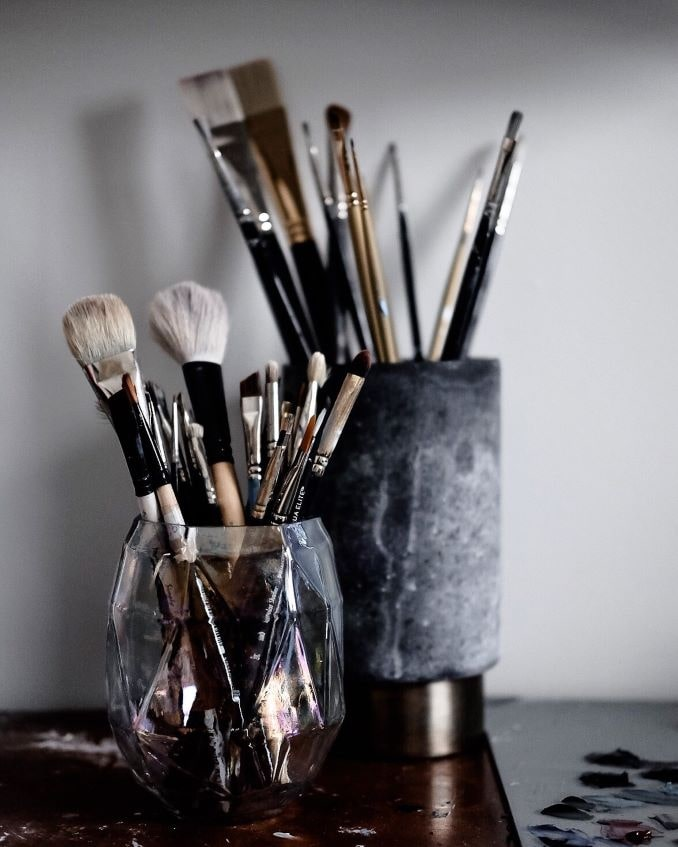 My paintbrushes, some of my most prized possessions. I like to re-use empty candle jars to hold them.