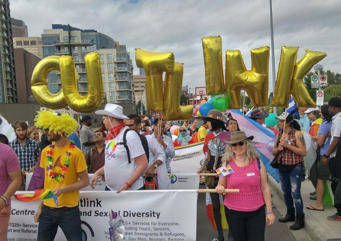 Outlink volunteers marching in the Calgary Pride Parade (2017)