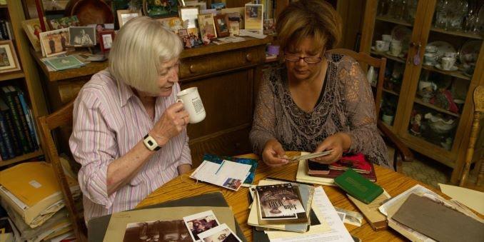 From John Ware Untamed: Cheryl Foggo exploring John Ware archives with Mary Mallory-min