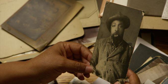 From John Ware Untamed: Cheryl Foggo examines a photograph of John Ware