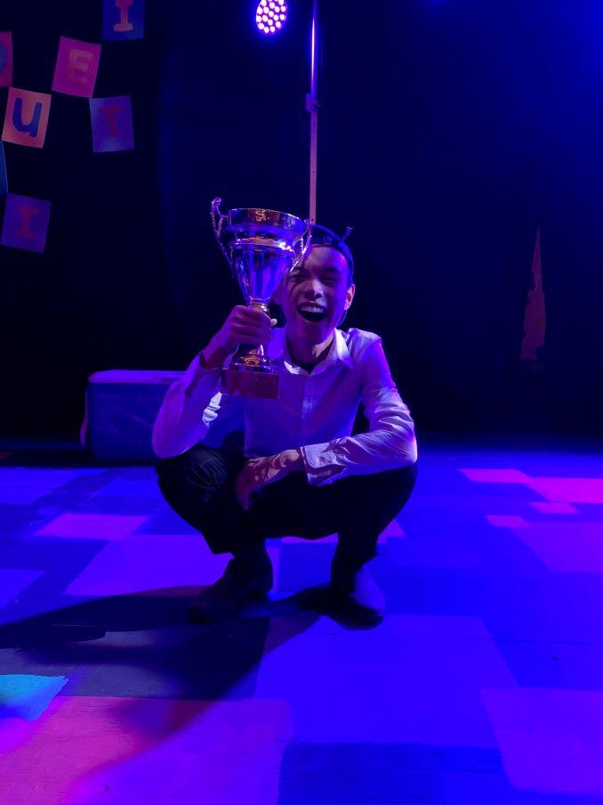 EJ Holding the winner's trophy in the Putnam County Spelling Bee.