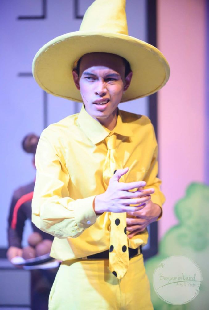 EJ as The Man in the Yellow Hat in Storybook Theatre's production of Curious George COLON The Golden Meatball in 2019. Photo by Benjamin Laird.