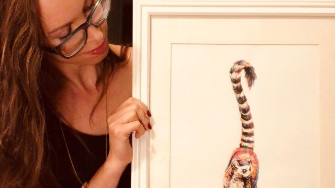 Sara This is me with my most popular showcase piece. This lemur always seems to catch peoples eye, and lures them over to take a look at my smaller pieces, haha!
