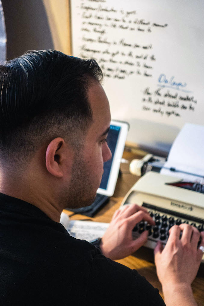 Hard at work, typing out another draft of a screenplay on the typewriter in the studio.