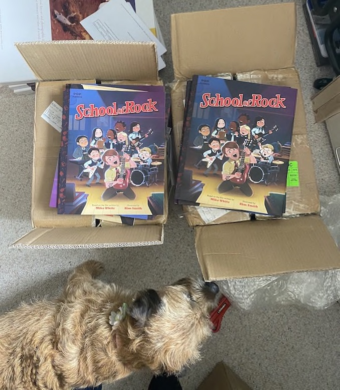 Some of the most exciting days are when I get book mail from the publisher. I just received copies of my next book, School of Rock, in the mail from Quirk Books! It's always so satisfying to see a book I worked on made into a real tangible thing. My office dog, Whisky, helps me check everything out.